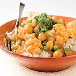INDIAN-STYLE CURRY WITH POTATOES, CAULIFLOWER, PEAS, AND CHICKPEAS