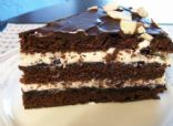 Choclate fudge cake with blueberry jam and whipped cream