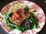 Salmon over black beans and spinach